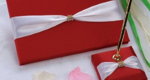 Remedios Boutique 2-Piece Bridal Accessory Set of Red Satin Guest Book and Pen with Pen Holder with Red Bow