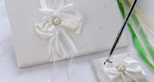 Remedios Boutique 2-Piece Bridal Accessory Set of White Bow Satin Guest Book and Pen with Pen Holder