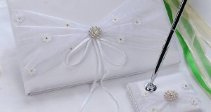 Remedios Boutique 2-Piece Bridal Accessory Set of White Satin Guest Book and Pen with Pen Holder with Embroidered Bow