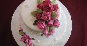 Beautifully Detailed Wedding Cake With Roses